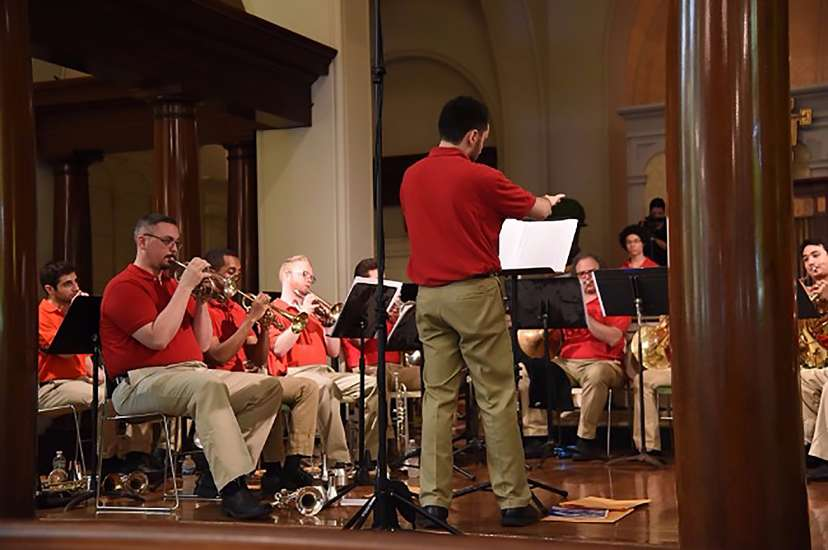 Steven conducts a performance of the Patriotic Brass Ensemble