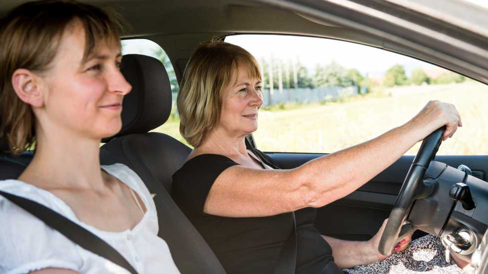 Spiritual Dream Symbols: Cars Senior woman driving with daughter. inspiration miracles