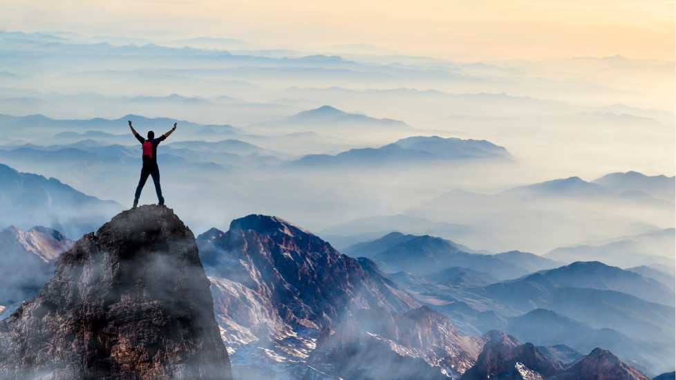 A figure on a mountaintop; Getty Images