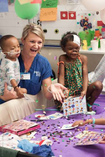 Heather enjoys a laugh with two of her young patients
