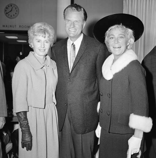 Graham poses with actresses Barbara Stanwyck (left) and Betty Hutton during a visit to Hollywood, California, on September 19, 1963.