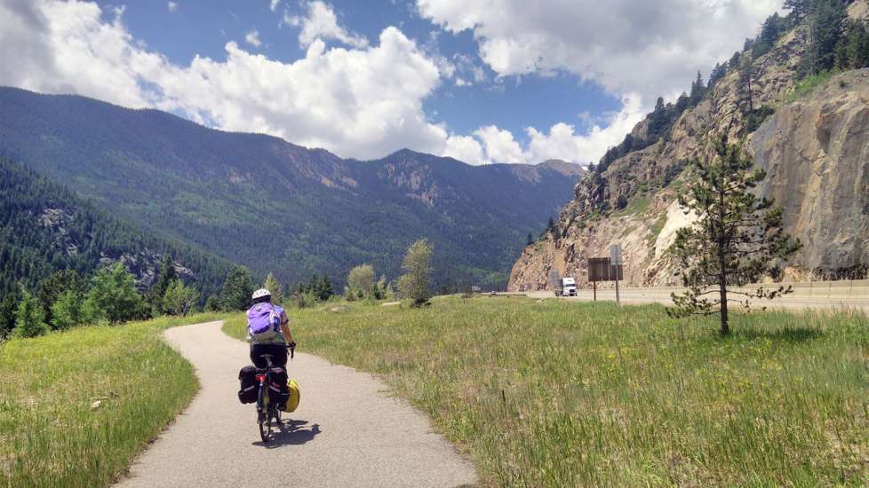 With the Rockie Mountains in the distance, Deborah continues her journey near Georgetown, Colorado