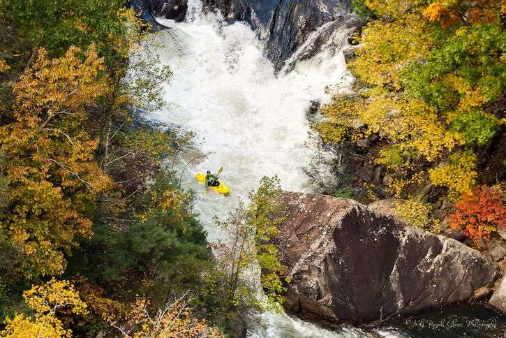 Guideposts: World-class kayakers descend on class 5 rapids during a scheduled water release on the Talullah Gorge, Tallulah Falls, Georgia.