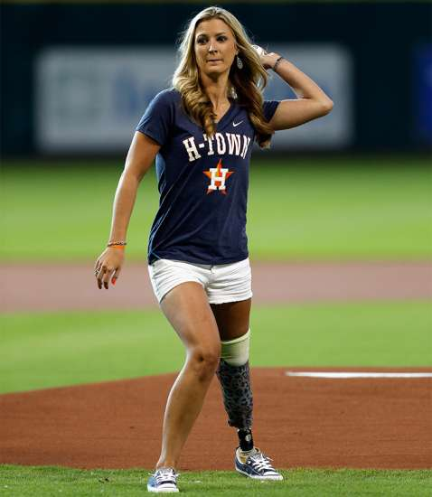 Some two years after the bombing, Rebekah throws out the first pitch at a Houston Astros game in Minute Maid Park.