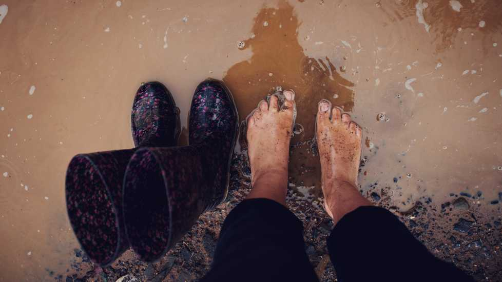 Standing in a muddy puddle; Getty Images