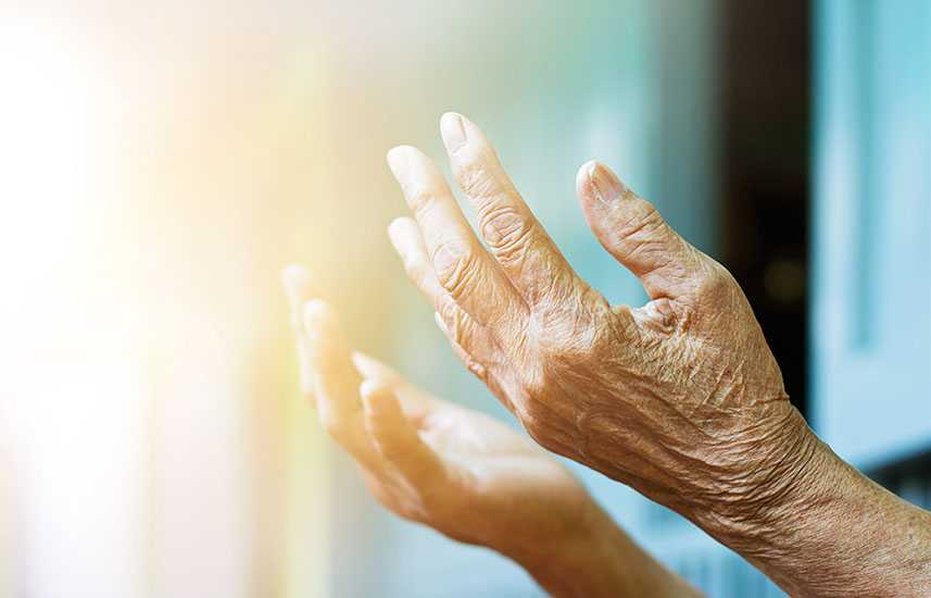 Elderly woman holding her hands out