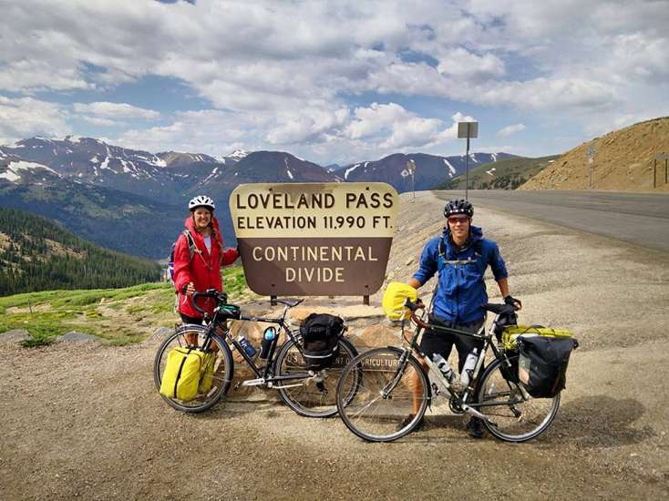 Deborah and her friend and traveling companion, Mark, pause at the summit of Colorado's Loveland Pass