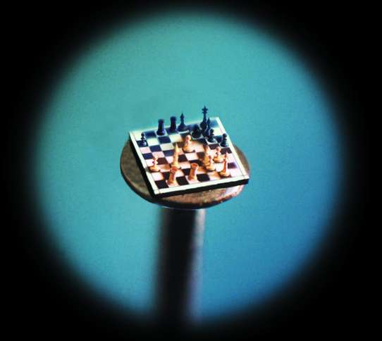 Guideposts: A chessboard—complete with gold chessmen—on the head of a pin