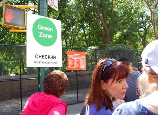 Guideposts: A sign for people in  the line to see Pope Francis in Central Park, New York City
