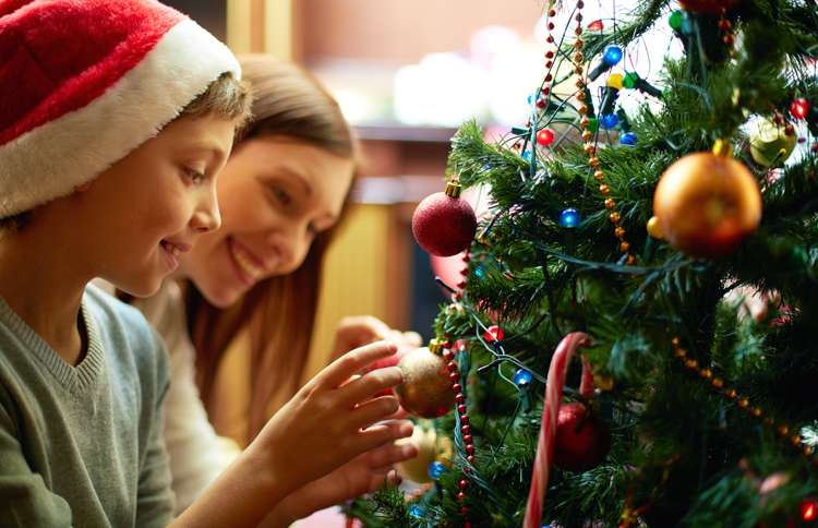 Guideposts: Mother and son smile as they decorate the Christmas tree
