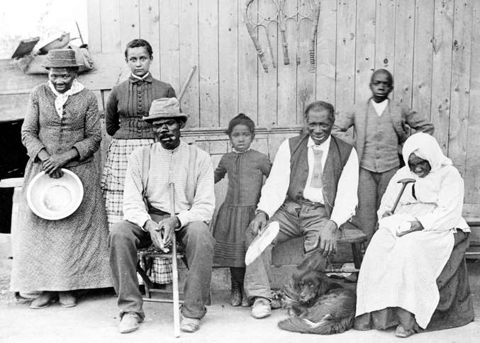 Guideposts: Harriet Tubman (far left) with family and neighbors, circa 1887, at her home in Auburn, NY.