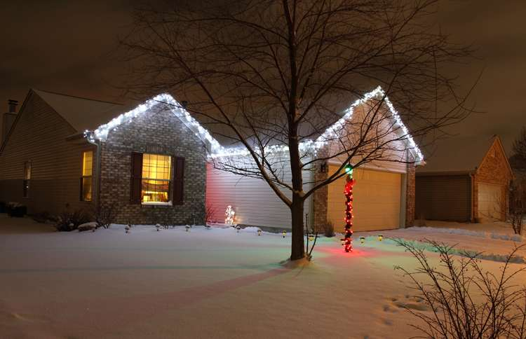 Guideposts: A modest home with a single string of white Christmas lights