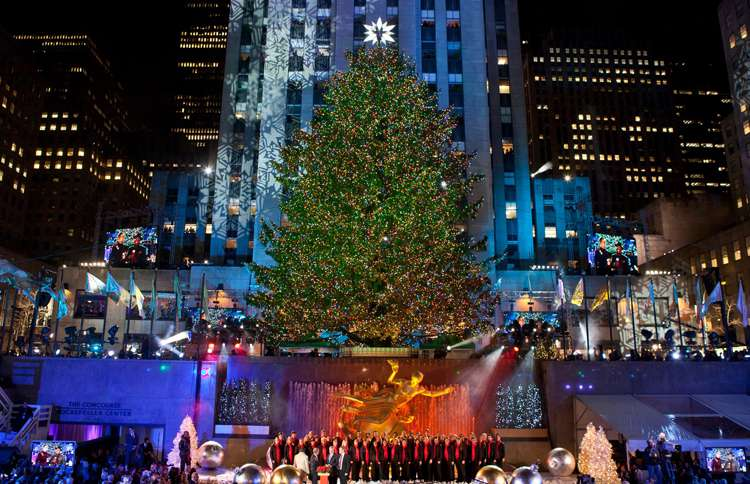 """Guideposts: The seven-story spruce that towers over the ice-skating rink in Rockefeller Center might arguably deserve to be called """"America's Christmas Tree."""""""