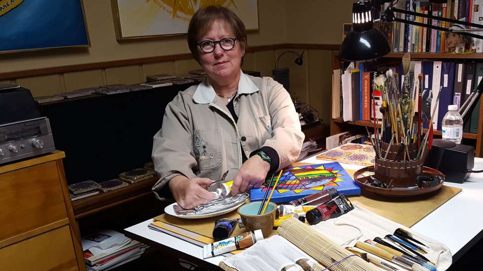 Linda Schadewald with the tools of her artistic trade