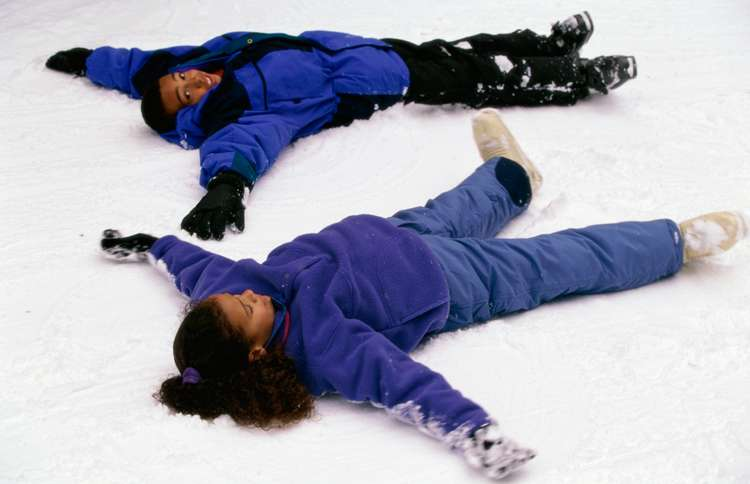 Guideposts: Two children lie in the snow making snow angels