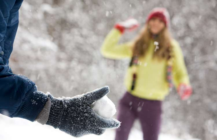 Guideposts: Two young people enjoy a friendly snowball fight