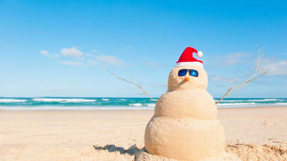 Snowman at the beach with sun glasses (Getty Images)