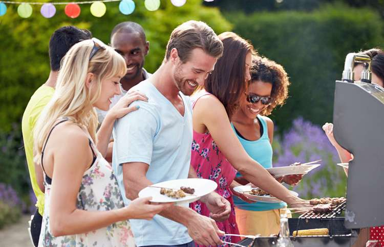 Friends having a summer barbeque