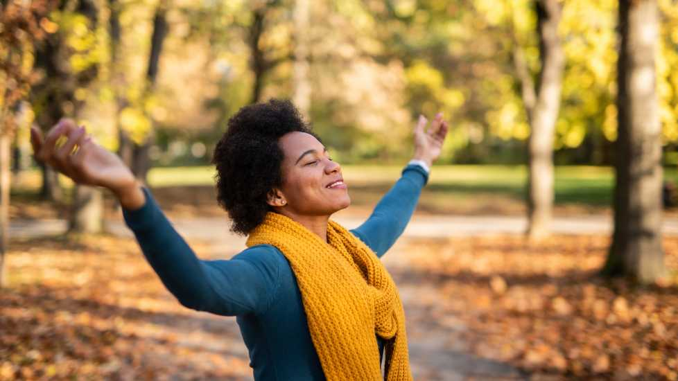 Woman in public park on beautiful autumn day (Getty)