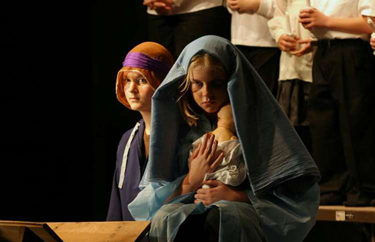 Two children portray Mary and Joseph in a church Christmas pageant