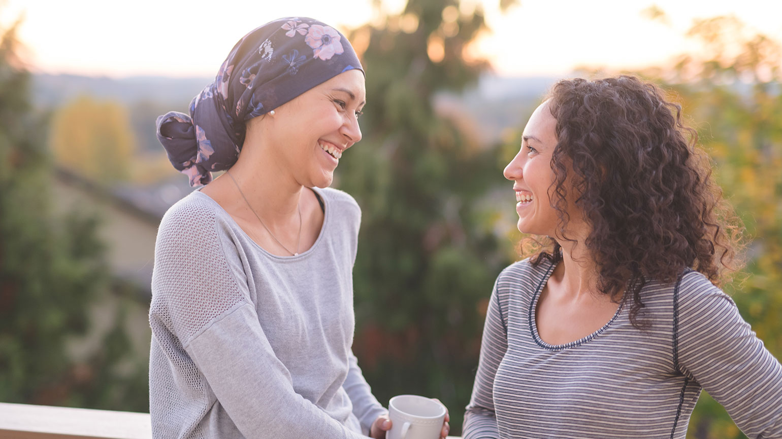 A woman with cancer receives encouragement from her friend