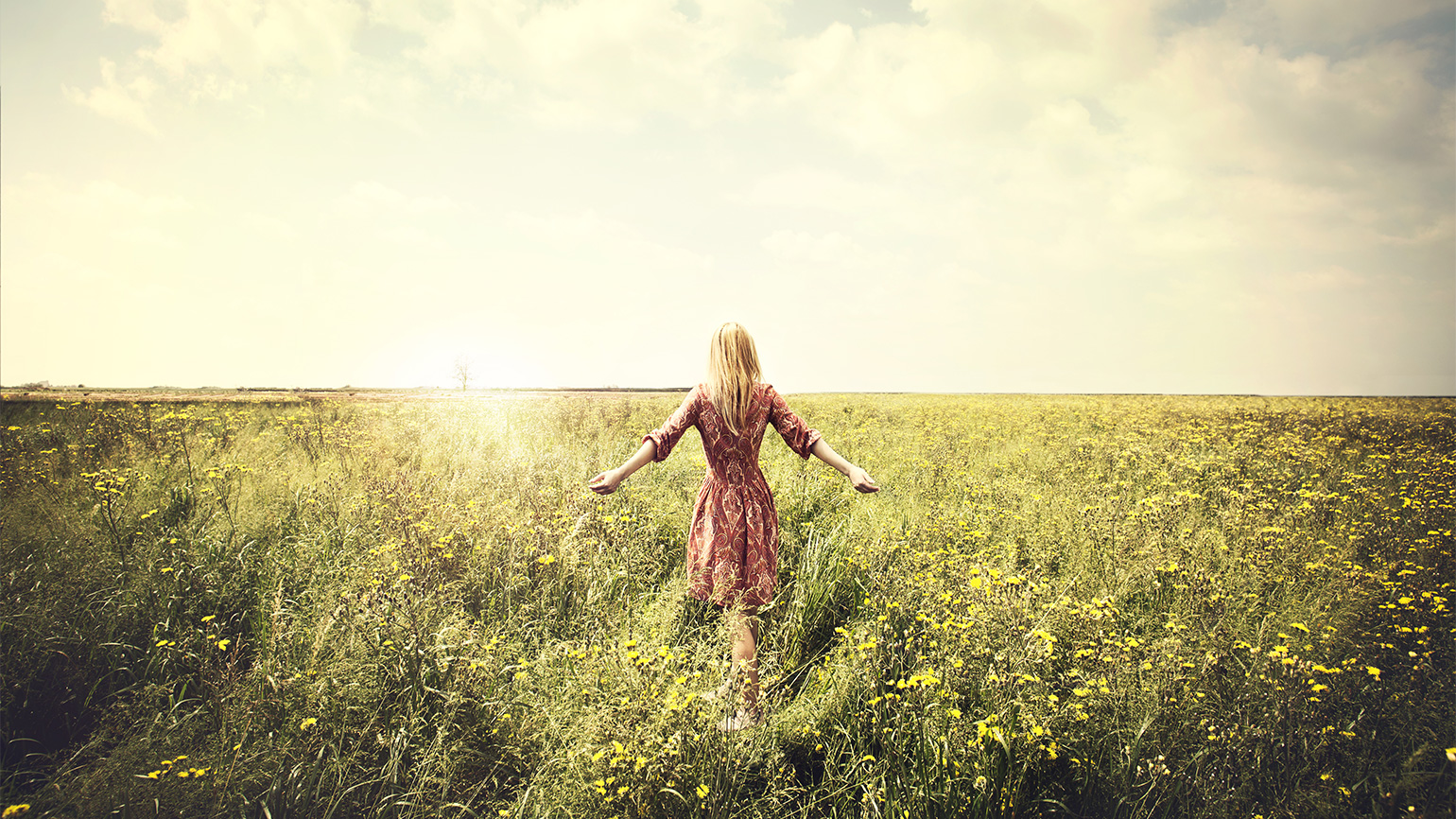 A woman in a sun-drenched field