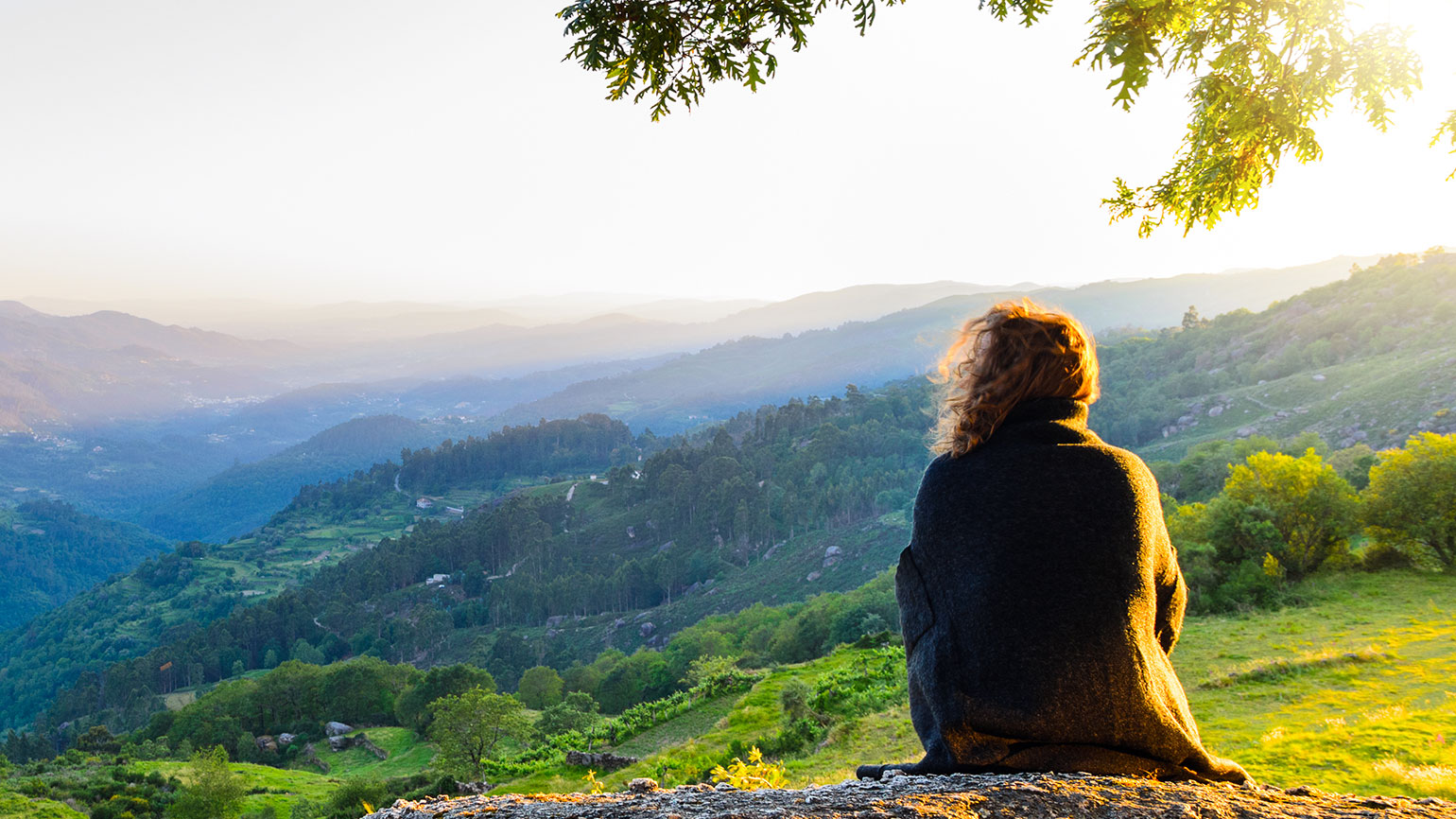 Woman sitting on a hill