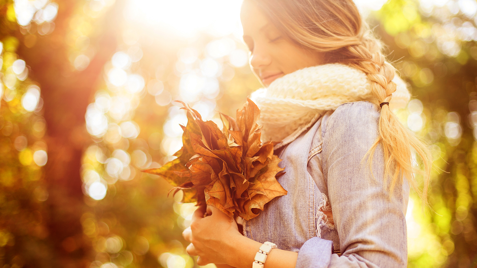 A young woman counts her blessings during a walk on an autumn afternoon