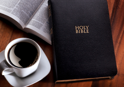 Bible and morning cup of coffee.