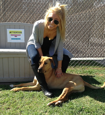 Michelle's daughter, Abby, visiting a dog shelter.