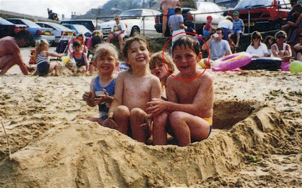 Young Nick and behind him, Amy playing in sand.