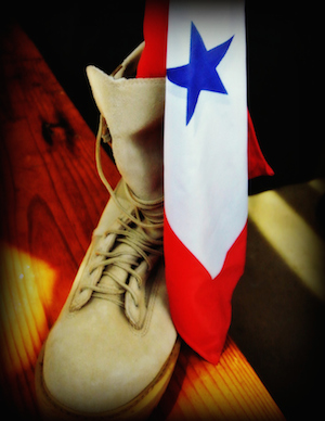 A boot pictured with a flag