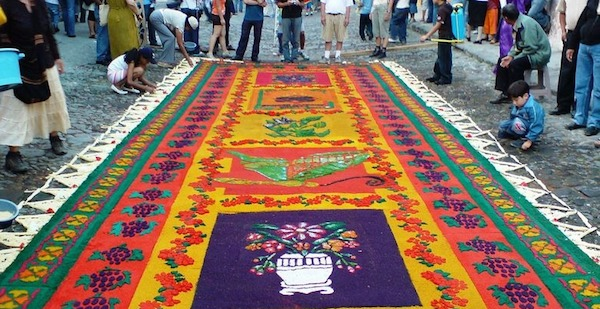 Colorful stenciled carpets made of sawdust, in Guatemala.
