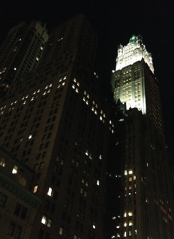 A shining skyscraper at night.