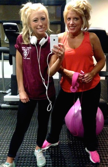 Michelle and her daughter Ally at their gym.