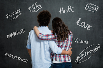 A young couple with arms around each other. Photo by Rido, Shutterstock.