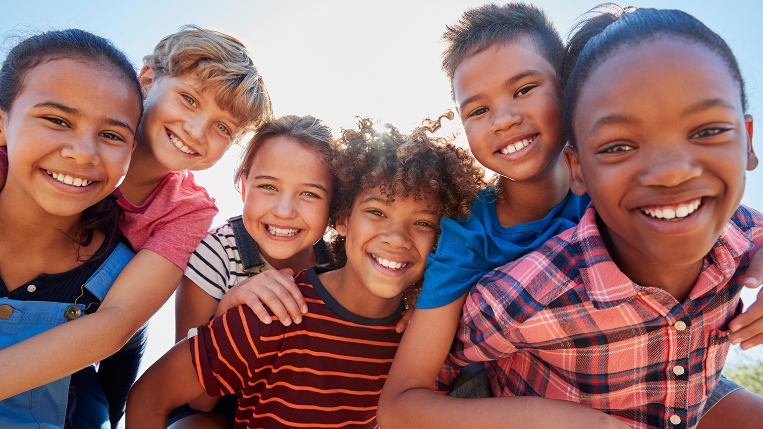 a close-knit group of smiling children