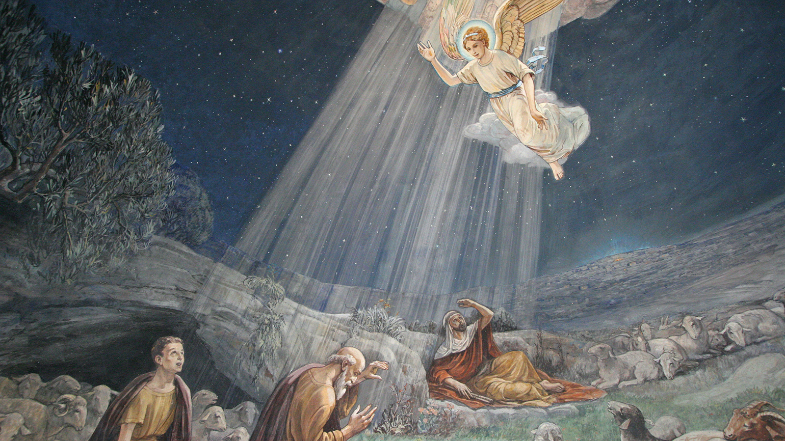 An angel brings new of Christs birth to shepherds in the fields