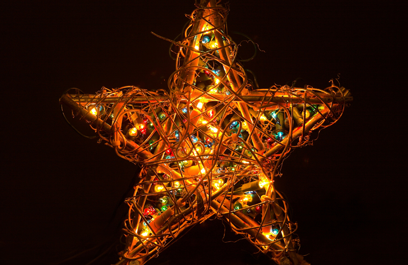 A star illuminated by many Christmas lights