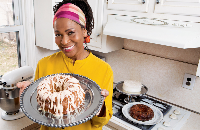 Angela poses with one of her Mortgage Apple Cakes.