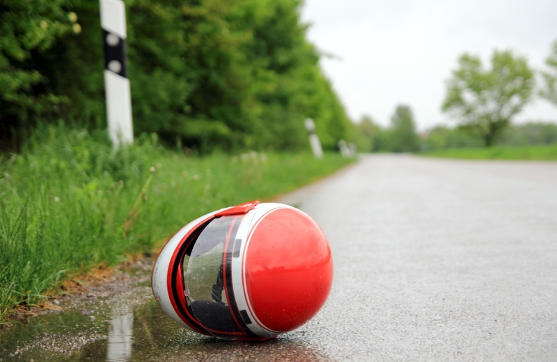 motorcycle helmet on the pavement, in the road