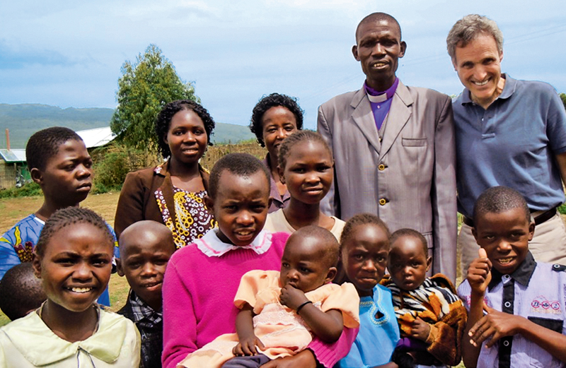 Rick Hamlin with Pastor Cornelious and some of his church congregants in Kenya
