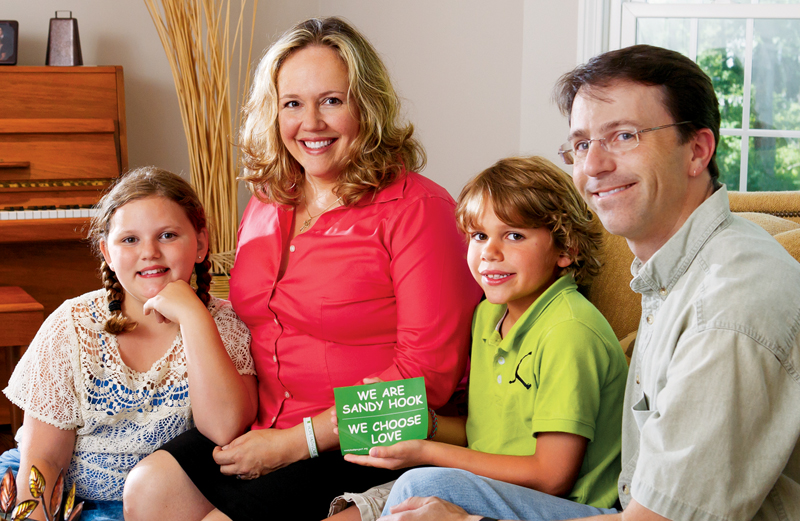 Katie, Julie, Eli and Tim pose with a We Choose Love sign