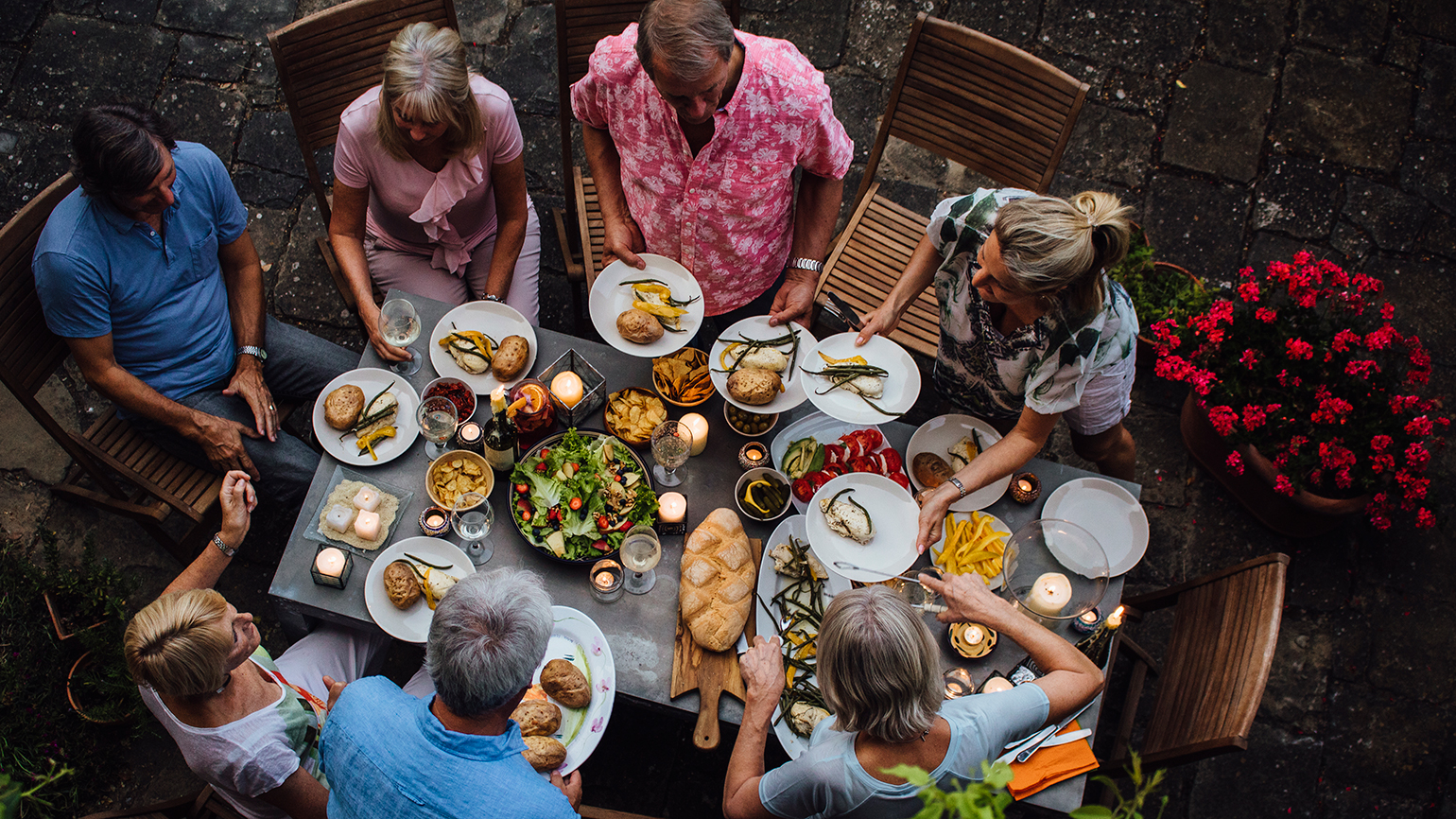 Friends gather around a dinner table