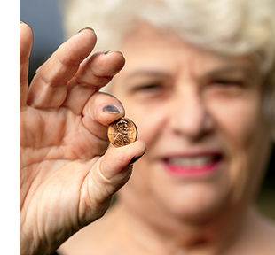 Linda displays the penny that calmed her