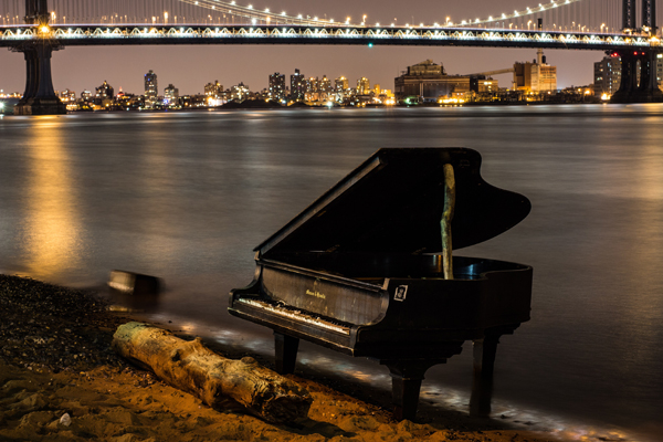 A grand piano on the banks of NYC's East River