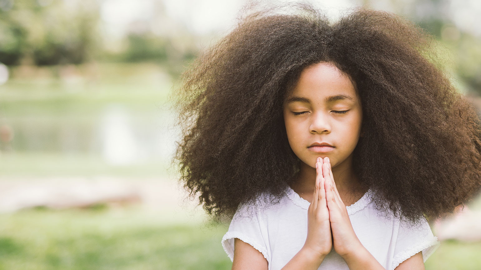 A young girl offers a prayer of thanks