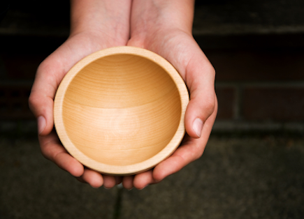 hands holding prayer bowl