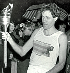 Rick Hamlin carrying th Olympic torch in 1984