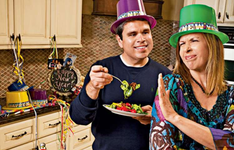 Michael Thompson tries to sway his wife Stephanie to try some black-eyed peas.